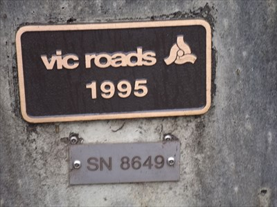 The smaller plaque on the northern side of the western end of this bridge, with the S/N plate below it: 8649 8 May, 2016