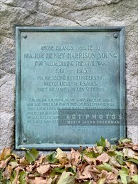 """The plaque reads: <br> RHODE ISLAND'S TRIBUTE TO <br> MAJOR HENRY HARRISON YOUNG <br> FOR VALOR, DURING THE CIVIL WAR, <br> 1861 - 1865. <br> MAJOR SECOND R.I. VOLUNTEERS INF.' <br> BREVET LIEUT. COL. U.S. VOLS. <br> CHIEF OF SCOUTS TO GEN. SHERIDAN. <br> <br> """"TO MAJOR H.H. YOUNG, OF MY STAFF, CHIEF OF SCOUTS, <br> AND THE THIRTY OR FORTY MEN OF HIS COMMAND, WHO <br> TOOK THEIR LIVES IN THEIR HANDS, CHEERFULLY GOING <br> WHEREVER ORDERED, TO OBTAIN THAT GREATEST ESSENTIAL <br> OF SUCCESS, INFORMATION, I TENDER MY GRATITUDE, TEN <br> OF THESE MEN WERE LOST."""" <br> P.H. SHERIDAN, <br> MAJOR GENERAL COMMANDING."""