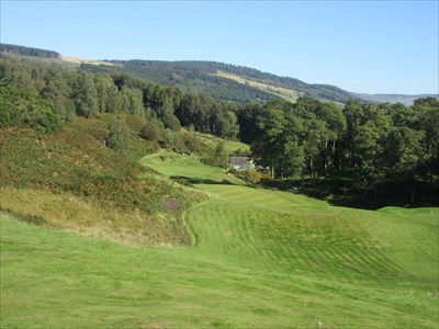 The view from the high tee at the sixth. the green is to the left of the distant cottage.