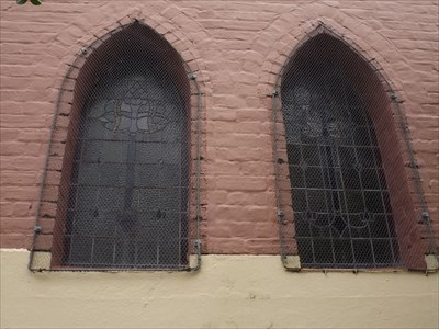 Two of the lead glass windows. Behind the pulpit, not overly intricate.
