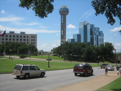 Looking across the plaza from the Bryan Colonnade, with Reunion Tower and the Cockrell Colonnade in the background.  The x on the road indicates the spot where President Kennedy received his fatal wound.