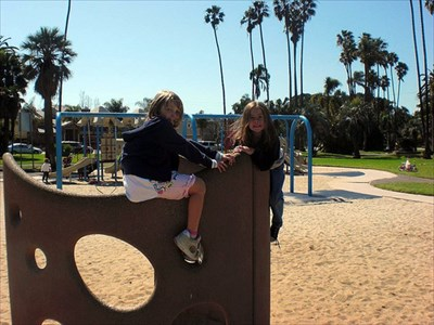 "Daughter and friend on ""swiss cheese."""