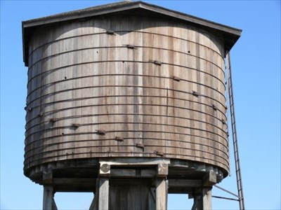 It looks like the group called Friends of the Beaumont Water Tower make sure maintenance is done well enough to keep these wooden sides strongly intact.