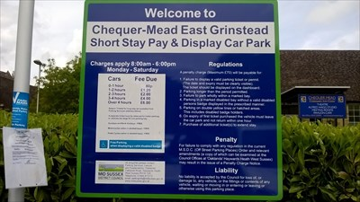 This is the sign in the car park which shows the charges for parking and other details about the car park.