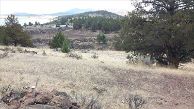View of pipe cap looking SE towards Hwy 97 in the background