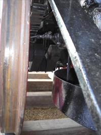 A view looking behind a driving wheel at the inside crank axle.