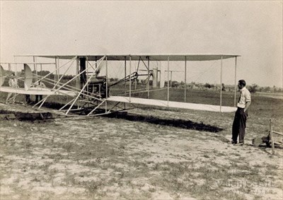 Photo of Orville on the Wright Flyer 1910.
