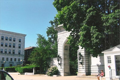 Civil War Memorial and east entrance to state house grounds, and State Bank on the left