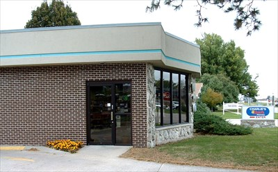 Charlie's U-Save's front door is on the southeast corner of the building.