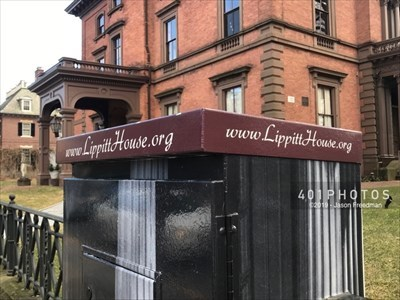 A decorative wrap customizes the utility box on the south side of Angell Street near the intersection with Hope Street to celebrate and promote the Lippitt House Museum, beside which it stands in Providence, Rhode Island. The museum's web address is presented on each side of the top rim: www.LippittHouse.org.