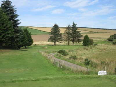 The par three 5th plays over the corner of an access road to a farm.