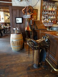 That saddle is a bar stool, one of several here.