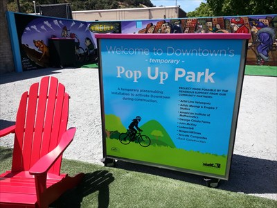 This temporary pop-up park occupies the space formerly occupied by the South Valley Bikes building. due to seismic retrofit issues, the building had been vacant for many years and was finally torn down to make way for new development. The park will remain in the meantime.