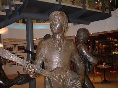 Close up of Paul McCartney statue which his part of The larger Beatles group statue in the Cavern Walks Shopping Centre