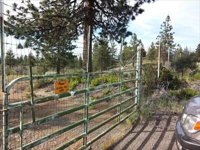 Metal access gate looking north towards AZ mark