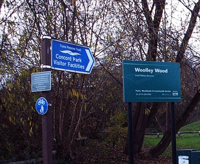 Signs to the wood, park and trans pennine trail.