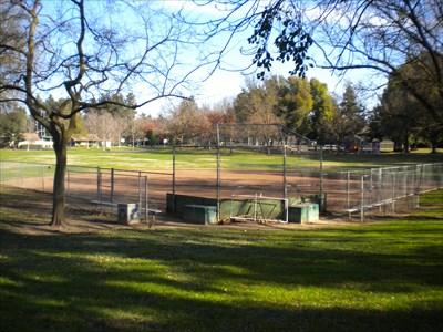 This photo shows the baseball diamond, playground, tennis courts, and basketball court.