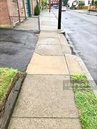View of the sidewalk - looking south towards Waterman Avenue