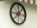 Image for Decorative Wagon Wheel at a balcony in Oeverich - RLP / Germany