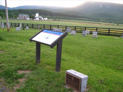 The Discovery Trail sign stands along a memorial marker.