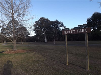 The Bailey Park sign, with the Dedicated Tree behind.