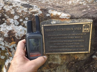 The plaque and boulder, with my GPSr, showing the coordinates. 1540, Saturday, 12 March, 2016