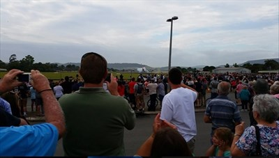 As a brief puff of smoke billows from the tyres, the crowd breaks into cheering and applause! The tyre pressures were reduced for this landing to help spread the weight of the aircraft.