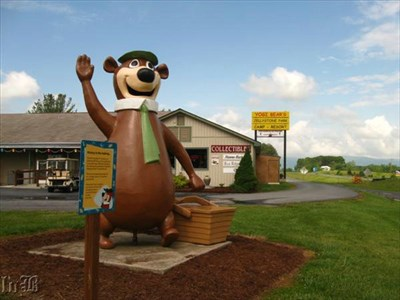 Yogi Bear stands near the road at Jellystone Park.
