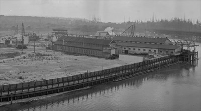 CVA – PAN N97 – [View of Granville Island from atop the north end of the Granville Bridge] 1919 W. J. Moore photo. (Note: This is a crop of the original WJ Moore panorama.)