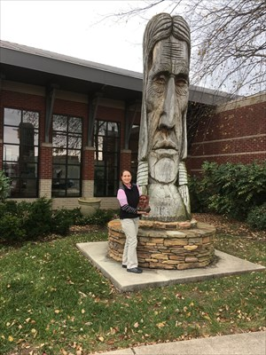 Carving by Peter Toth to recognize the Cherokees and the importance of the Bradley County area and the Trail of Tears.  Pictured with the sculpture is a miniature replica of the Cherokee Chieftain that was also completed during the original carving.