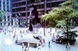Here you see the Daley Plaza, the Picasso sculpture, and the Blues Mobile speeding across the busy plaza.