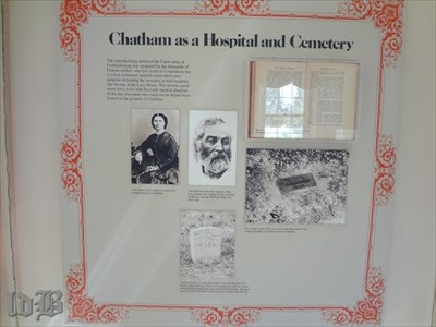 An exhibit on a wall inside Chatham about its use as a hospital and cemetery