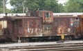 Image for Red (rusty) PAL Caboose - TRRA Gateway Rail Services Storage Yard, Madison, IL