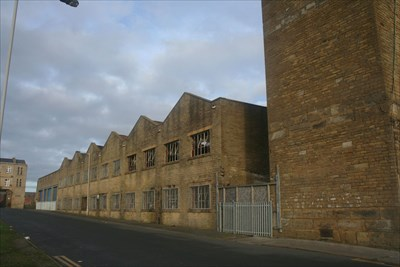The mill building next to the chimney has yet to be converted.