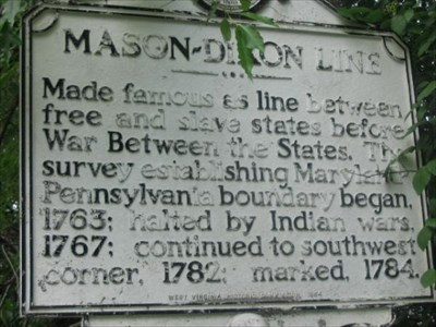 An historical marker across the road from the stone