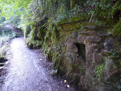The old fireplace visible in the rock.