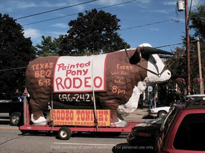 The Painted Pony Rodeo rolling billboard: a GIANT statue of a bull. It is mounted on a flatbed trailer and pulled through Lake George by a pickup truck. You can't miss it!