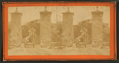 This photo was taken from Wikipedia and is dated from about 1868?-1905? http://commons.wikimedia.org/wiki/File:City_gates,_looking_into_St._George_Street._St_Augustine,_Florida,_from_Robert_N._Dennis_collection_of_stereoscopic_views.png