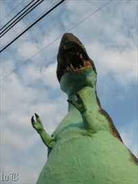 Dino looks ready to munch down on some power lines.