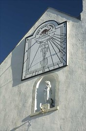 NIce sundial visited on a cold sunny day.