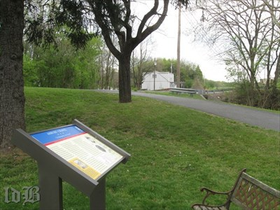 Near the white building seen in background is Rocky Lane, the road the Confederate troops followed to Front Royal.