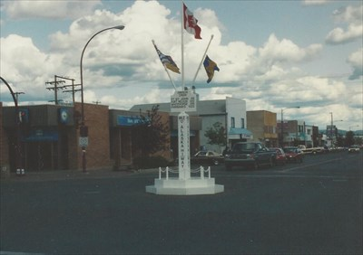 Take a close look and you'll see slight differences in how the signpost looked in 1992 and how it looks today.
