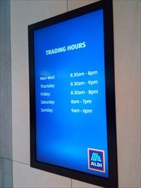 The Trading Hours - on a rolling LED display. 0907, Saturday, 18 May, 2019