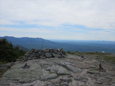 Footings from the old fire tower, and a stone windbreak at the summit