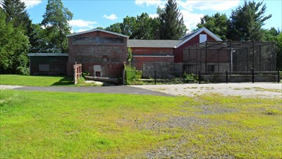 Once in disrepair, now cleaned up. The barn on the right has been restored along with the cages and fences