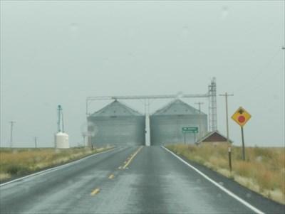 The Farmer schoolhouse and silos.