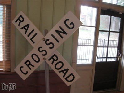 Sign in the room where the model railroad is located.
