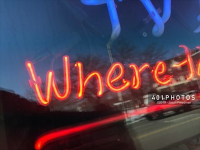 "Detail: the word ""Where"" in red neon"