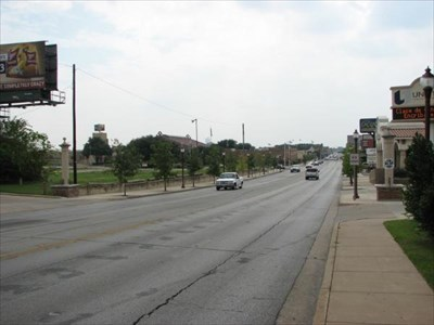 View from Main Street, looking south into the District. A marker pillar can be seen on each side of the street.