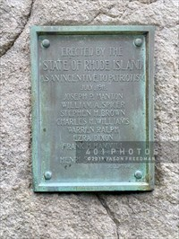 The plaque reads:<br> ERECTED BY THE <br> STATE OF RHODE ISLAND <br> AS AN INCENTIVE TO PATRIOTISM <br> JULY, 1911. <br> JOSEPH P. MANTON <br> WILLIAM A. SPICER <br> STEPHEN H. BROWN <br> CHARELS H. WILLIAMS <br> WARREN RALPH <br> EZRA DIXON <br> FRANK H. HAMMIL <br> COMMISSIONERS. <br> HENRI SCHONHARDT <br> SCULPTOR </center> </blockquote>